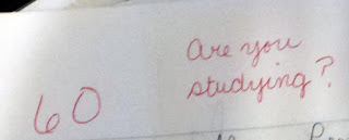 """The number 60 written in red ink on the left side of the image, with the words """"Are you studying?"""" written on the right"""