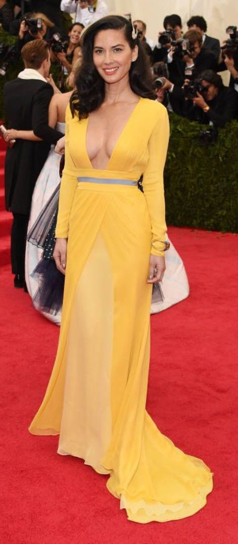 Olivia Munn in a shiny yellow Diane Von Furstenberg dress at the Met Gala 2014