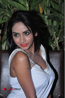Actress Model Pooja Sri Stills in White Short Dress at F Club pre soft Launch  0218.JPG