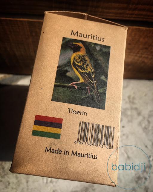 oiseau Tisserin qui illustre une boîte d'épices mauriciennes