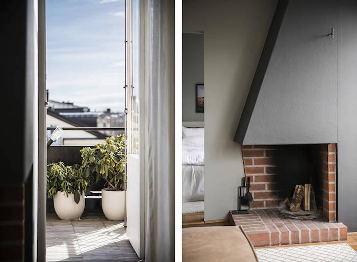 Salón con paredes verdes y sofá gris. Acceso a la terraza e imagen de la chimenea