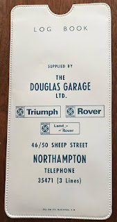 Douglas Garage branded log book cover