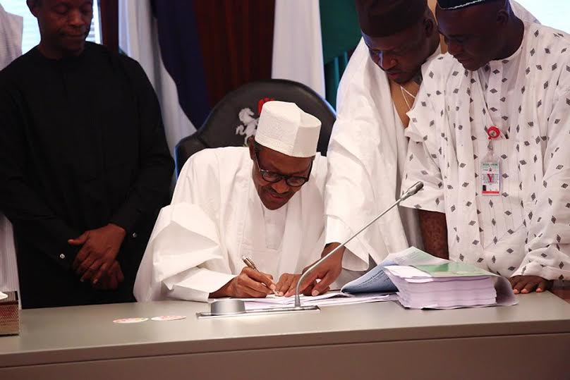 4 Photos: President Buhari signs the 2016 Budget