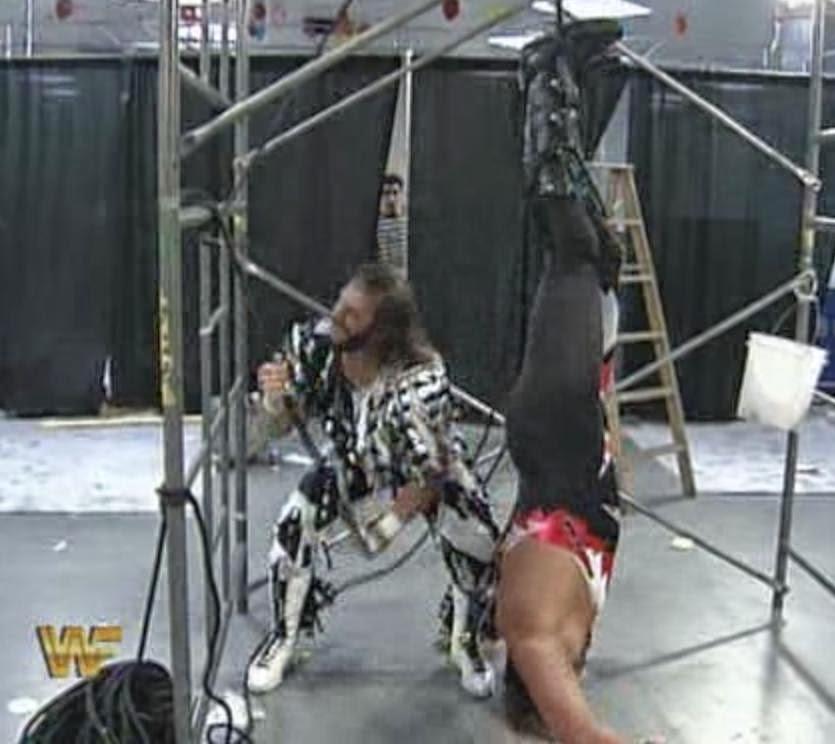 WWF / WWE: Wrestlemania 10 - Randy Savage hangs Crush upside down in their Last Man Standing Match