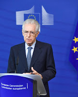 a photo of Mario Monti standing at a European Commission podium