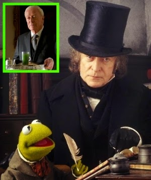 Holy Bah-Humbug! Batman's butler Michael Caine stars as Scrooge in 1992's THE MUPPET CHRISTMAS CAROL with Kermit the Frog.
