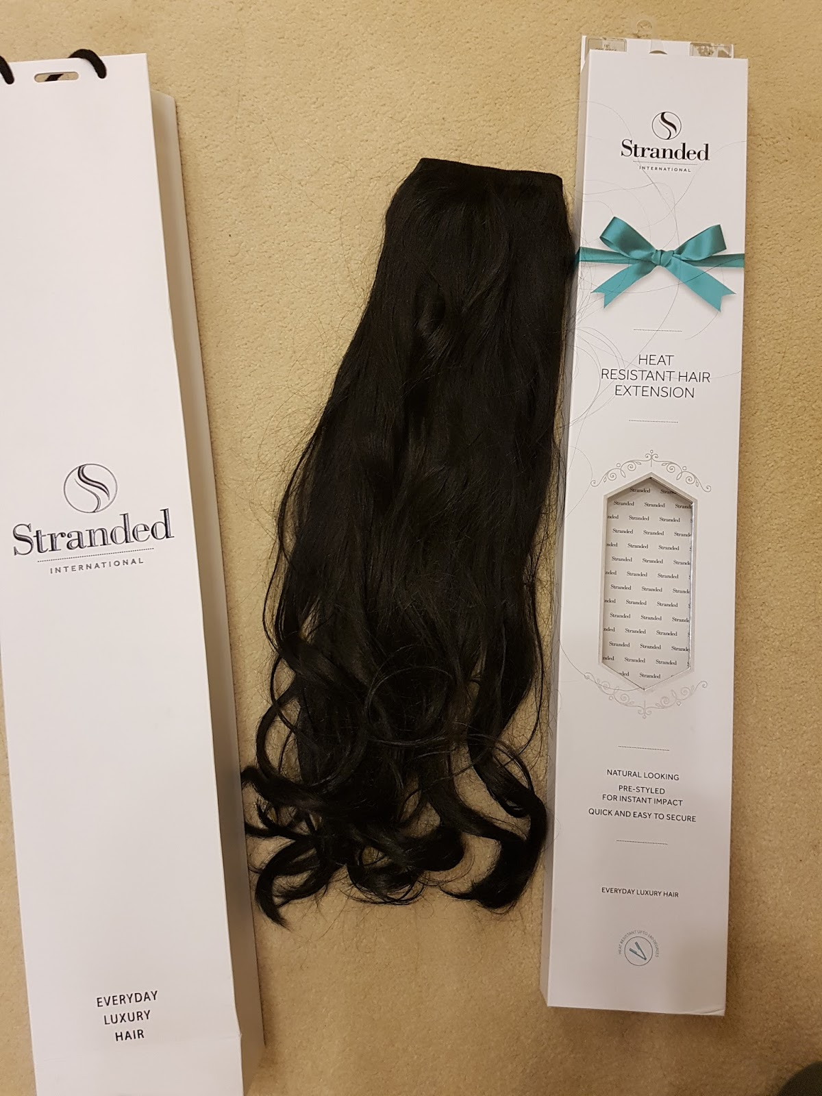 Stranded International Hair Extensions 18 Curly 1 Black Magic