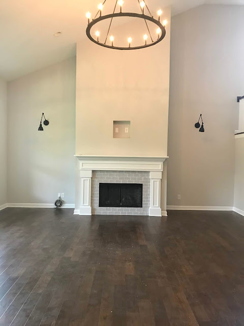 Tall fireplace with gray tile