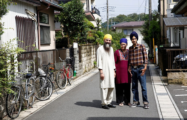Image Attribute: Gursewak Singh (R) and his parents pose for a photographer next to their house (L) during an interview with Reuters, in Matsudo, Japan, September 25, 2016.    REUTERS/Kim Kyung-Hoon