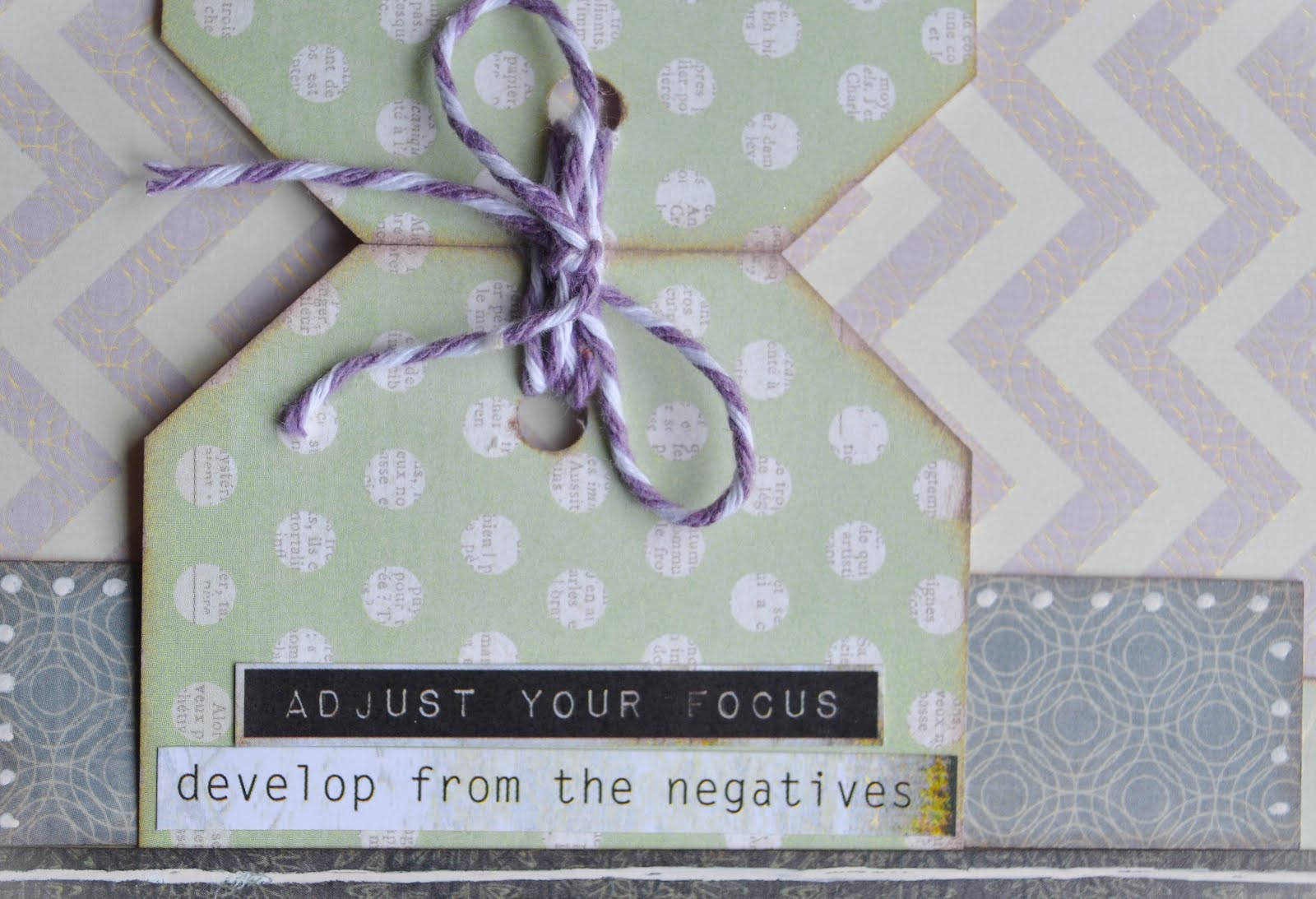 Scrapbook layout in lavender, mint green, and charcoal with chevron, polka dots, uniball white pen outlining, tags, paper layering, and liquid pearls about photography