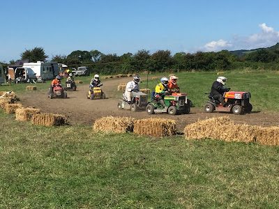 Picture of lawnmowers racing at the Mendip Mower Racing Family Festival 2016 - grand prix race