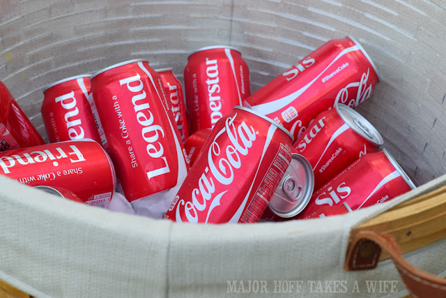 Share a Coke with a friend. Everyone loves a basket full of Coke!