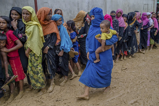 Rohingya refugees queue for food and shelter in Bangladesh