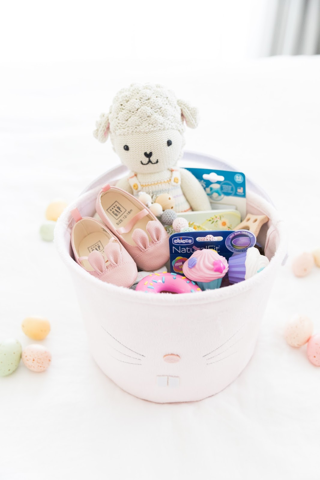 Easter baskets for baby and toddler sweet september even though hannah is only 9 months old i still wanted to make her a basket since its her first easter heres a list of the gifts i put in her basket negle Gallery