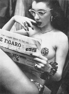 Pin-up girl reading news paper