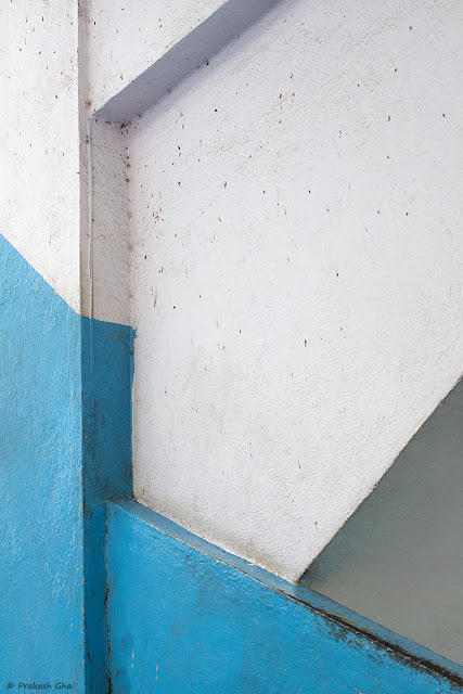 A Minimalistic Image of a Wall with Multiple Lines and Blue Paint at Orbit Mall Jaipur. Picture captured  via Canon EOS 6D Mark II DSLR Camera.