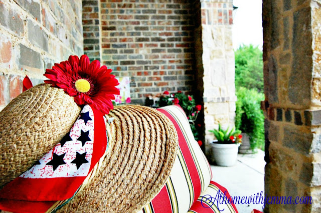 Decorate with red geraniums, petunias, faux red vines, bandanna, straw hat
