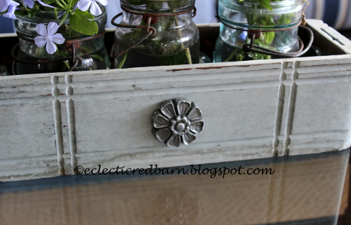 Sewing drawer with wooden flower attached