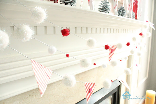 White and red pom pom garland to decorate mantel