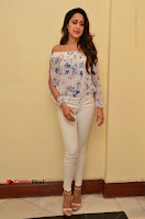 Actress Pragya Jaiswal Latest Pos in White Denim Jeans at Nakshatram Movie Teaser Launch  0041.JPG