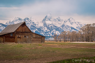 Cramer Imaging's fine art landscape photograph of the Moulton Barn against the mountains of Grand Teton National Park Wyoming