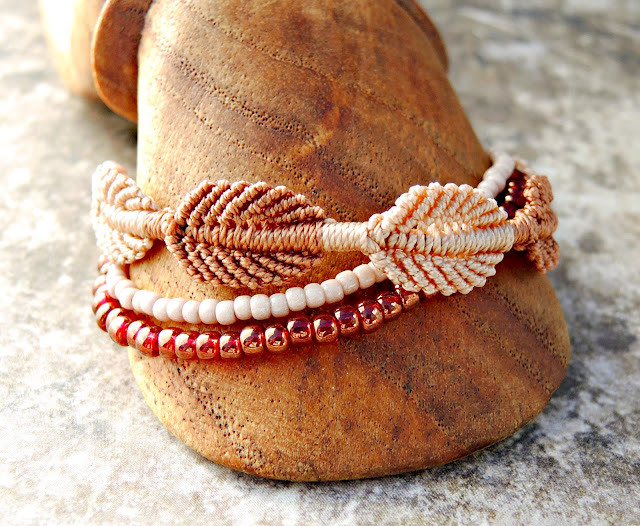 Micro macrame feathers and beaded strands.