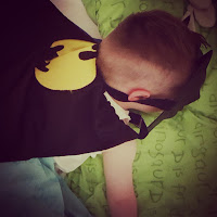 Sleeping two-year old in Batman mask