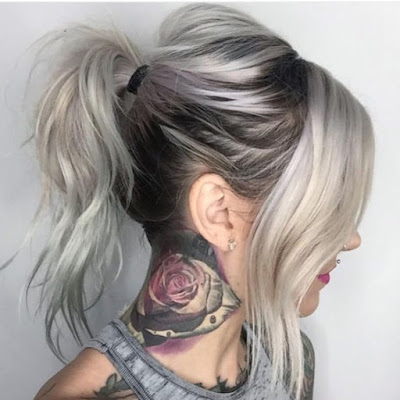 edgy gray hair and neck tattoo