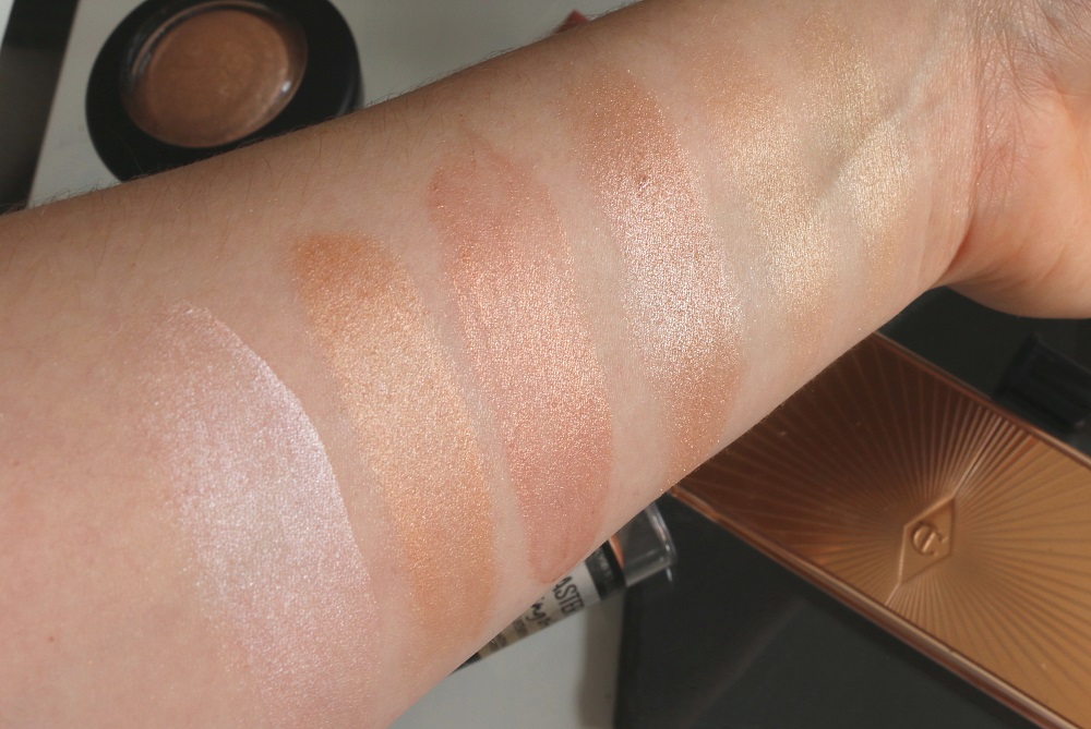 Top Highlighters Featuring Benefit's High Beam, Maybelline's Master Strobing Stick, NARS Orgasm Illuminator, MAC's Soft & Gentle Mineralize Skinfinish, Charlotte Tilbury's Filmstar Bronze & Glow and theBalm's MaryLou Manizer.