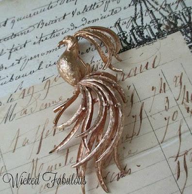 https://www.etsy.com/listing/463761596/gorgeous-vintage-avon-fantasy-bird-pin?ref=shop_home_active_1
