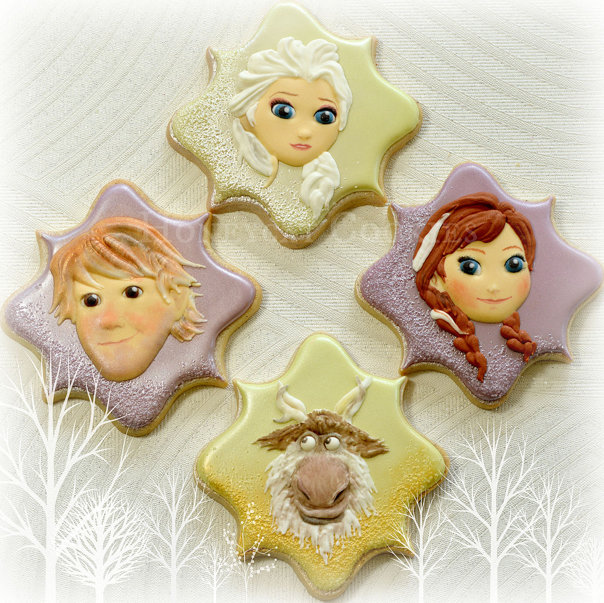 Elsa, Anna, Christoff and Sven from Disney's Frozen decorated character cookies, photo by Honeycat Cookies