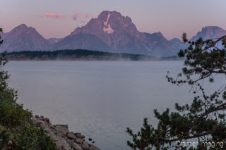 Cramer Imaging's quality landscape photograph of Jackson Lake reservoir with mist at sunrise in Grand Teton National Park Wyoming