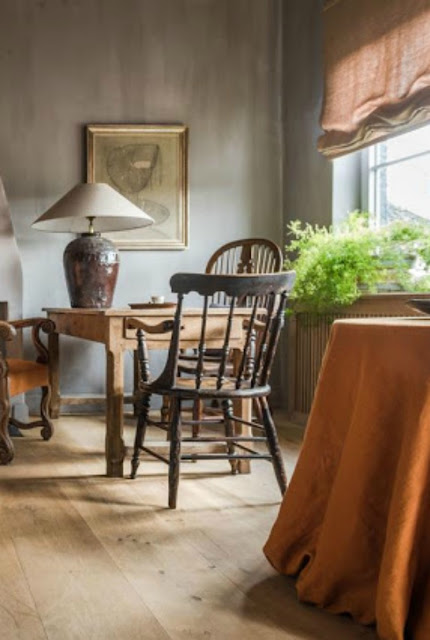 Belgian style dining room with rustic decor and natural wood - found on Hello Lovely Studio