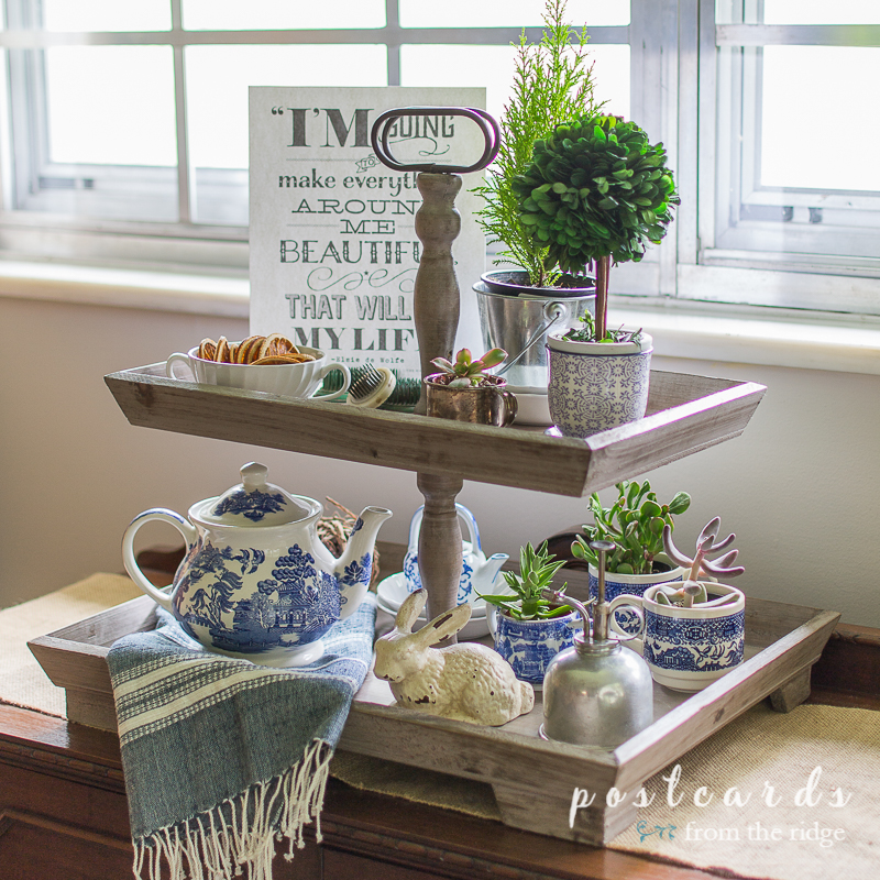 blue and white decor in a wood tiered tray
