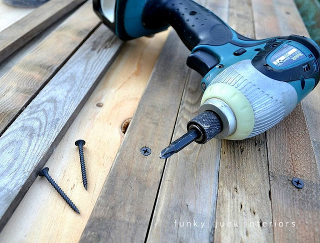 Why pre-drilling holes in old wood is so important before screwing them down... click to visit tutorial.