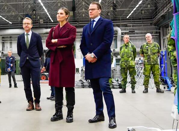 Crown Princess Victoria and Prince Daniel visited the military field hospital. burgundy wool cashmere coat