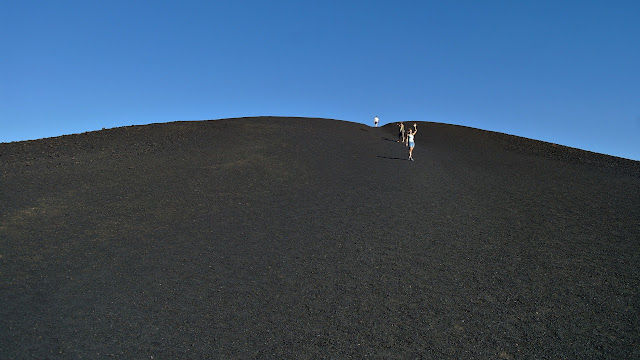 Trudging up a mountain of volcanic pumice...