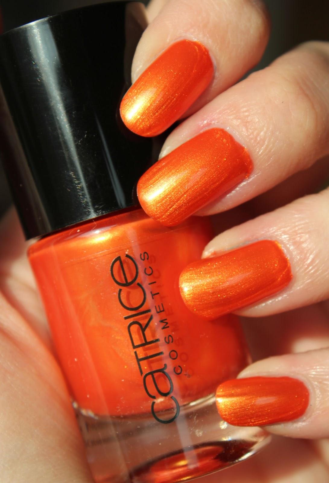 http://lacquediction.blogspot.de/2014/03/catrice-ultimate-nail-lacquer-47-orango.html