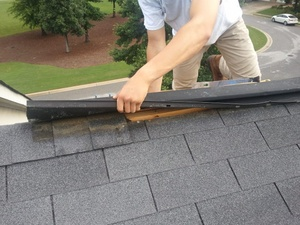 A person working on repairing a rooftop in Winter Garden, FL