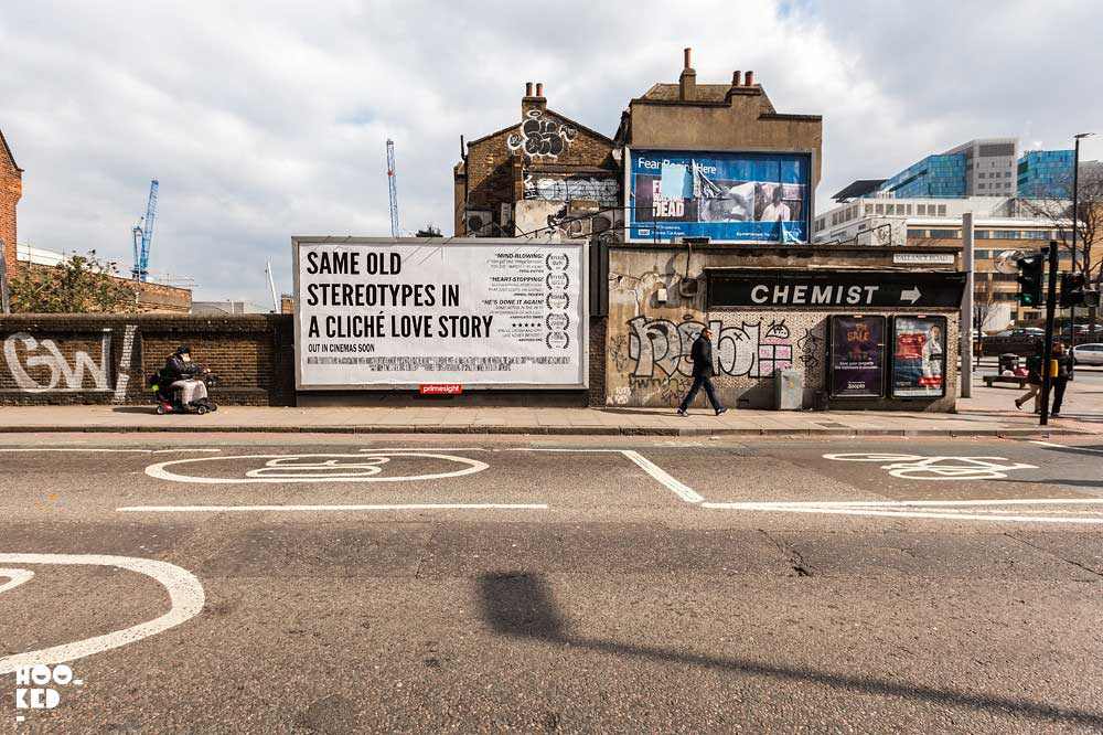 Hijacked Billboards with Fake Movie Poster by Street Artist Mobstr