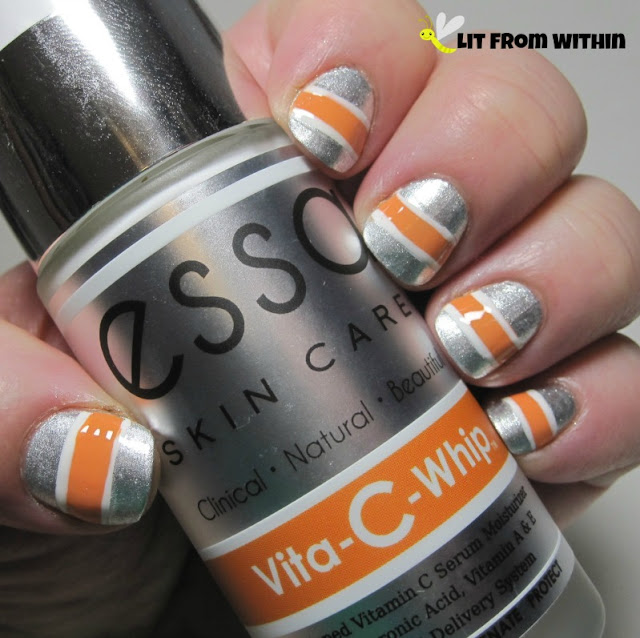 Loving this silver polish! I was inspired by the packaging to create this silver nailart with orange and white.  The base is Essie Apres-Chic, and the stripe is OPI Where Did Suzi's Man-Go with white striper accents.