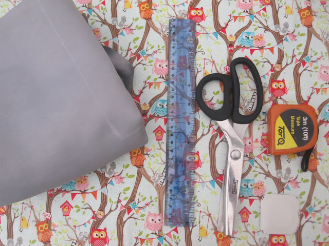 Fabric, ruler, scissors, tape and tailors chalk