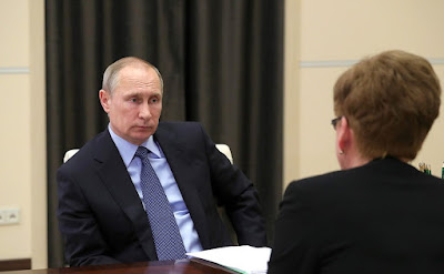 Vladimir Putin at a meeting with Trans-Baikal Territory Governor Natalya Zhdanova.