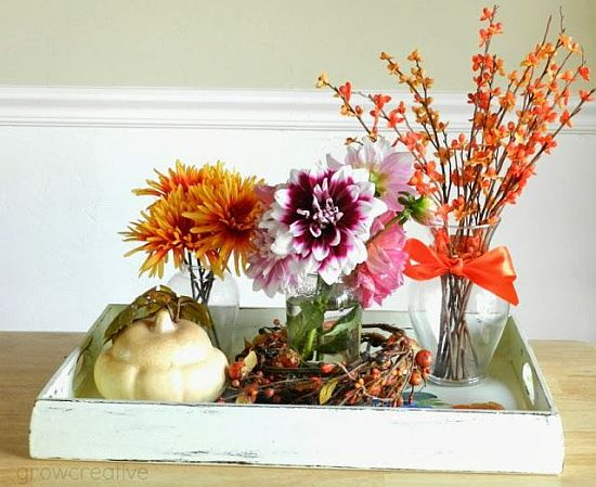 pretty fall decoration with flowers and branches
