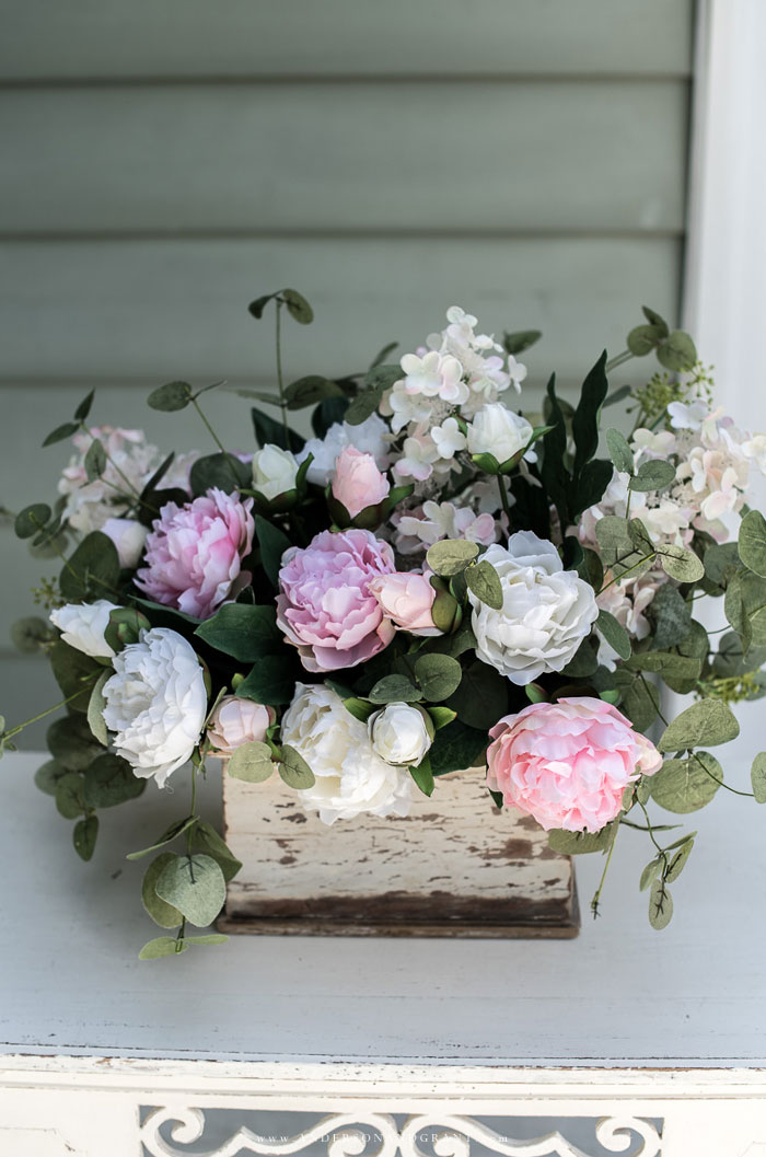 Arrangement of peonies, hydrangea, and eucalyptus