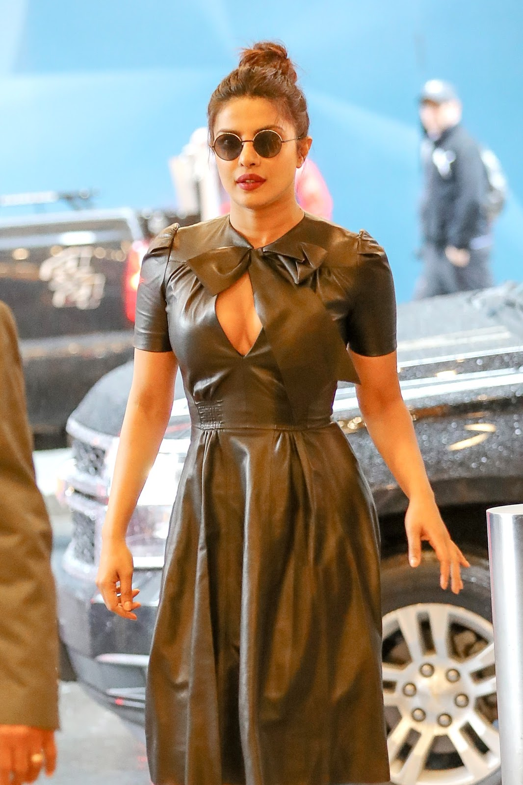 Priyanak Chopra in Stunning Black Goggles Leather Frock and Boots in a Rainy Day New York