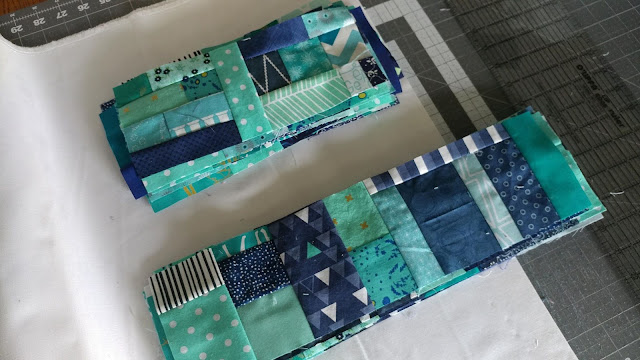 Detour quilt in aqua and navy from Stash Statement quilting book by Kelly Young