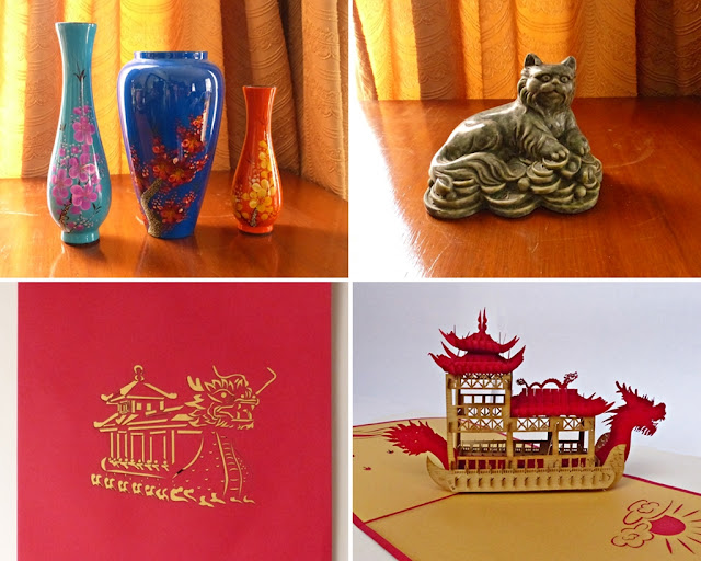 Souvenirs from Vietnam: vases, marble cat figurine and paper cut card