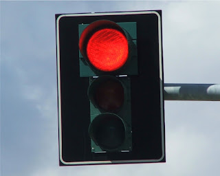 Can I cut through a parking lot to avoid a red light in