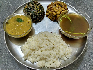 Polished white rice,  Pigeon lentil dhaal,  Ponnaanganni greens poriyal,  Lima Beans curry,  Kokum rasam